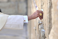 Pope Benedict XVI places a note into a crack of the Western Wall, Judaism's holiest site in Jerusalem's Old City, Tuesday, May 12, 2009..
