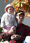 Ted Wiberg, of Dayton, watches the Nevada Day parade with his granddaughter Rylee Wiberg, 1, in Carson City, Nev. on Saturday, Oct. 27, 2012. .Photo by Cathleen Allison