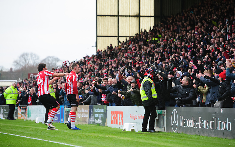Lincoln City's Harry Toffolo, right, celebrates scoring the opening goal with team-mate Michael Bostwick<br /> <br /> Photographer Chris Vaughan/CameraSport<br /> <br /> The EFL Sky Bet League Two - Lincoln City v Grimsby Town - Saturday 19 January 2019 - Sincil Bank - Lincoln<br /> <br /> World Copyright &copy; 2019 CameraSport. All rights reserved. 43 Linden Ave. Countesthorpe. Leicester. England. LE8 5PG - Tel: +44 (0) 116 277 4147 - admin@camerasport.com - www.camerasport.com