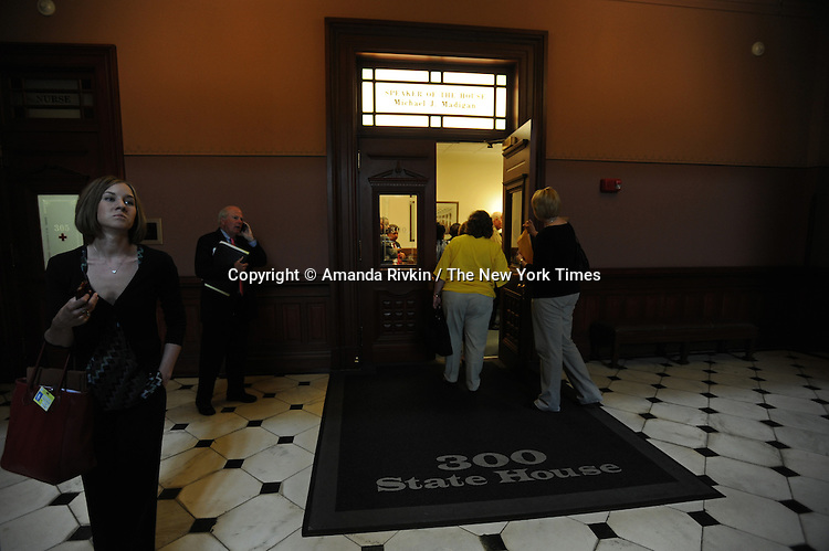 Lobbyists, legislators, assistants and others pour in and out of Illinois Speaker of the House Michael Madigan's office between the chambers of the Illinois Senate and House during the closing marathon legislative sessions, expected to end Sunday, that marks the end of the legislative year in Springfield, Illinois on May 27, 2009.  Madigan was in closed door meetings and unavailable for photographs.