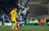 Matt Bloomfield of Wycombe Wanderers goes up for the ball during the Sky Bet League 2 match between Wycombe Wanderers and Bristol Rovers at Adams Park, High Wycombe, England on 27 February 2016. Photo by Andrew Rowland.