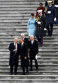 United States President Donald Trump and former US President Barack Obama walks on the steps of the Capitol in Washington, Friday, Jan. 20, 2017, with Vice President Mike Pence and former Vice President Joe Biden along with with first lady Melania Trump and Michelle Obama, prior to the Obama's departure to Andrews Air Force Base, Md., following the presidential inauguration. <br /> Credit: Rob Carr / Pool via CNP