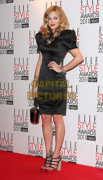 FEARNE COTTON.The ELLE Style Awards 2011 at Grand Connaught Rooms, London, England..February 14th, 2011.full length black puff sleeve dress hand on hip necklace bag handbag strappy sandals platform .CAP/ROS.©Steve Ross/Capital Pictures