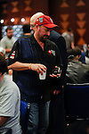 Team Pokerstars.net Pro Dennis Phillips reaches for his identification