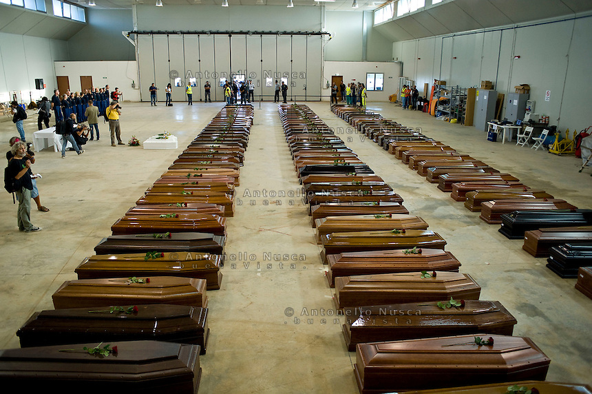 Le bare dei 110 clandestini morti nel naufragio al largo delle coste di Lampedusa, nell'hangar dell'aeroporto. Coffin of victims are seen in an hangar of Lampedusa airport on October 5, 2013 after a boat with migrants sank killing more than hundred people.
