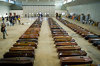 Le bare dei 110 clandestini morti nel naufragio al largo delle coste di Lampedusa, nell'hangar dell'aeroporto. Coffin of victims are seen in an hangar of Lampedusa airport on October 5, 2013 after a boat with migrants sank killing more than hundred people.