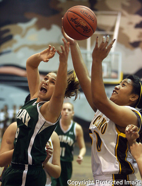 Poway's Katie Kuklok, left, and El Camino's Naomi Amu go up for a rebound in 2010.  photo for North County Times