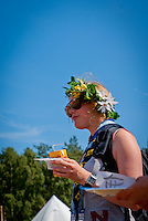 Swedish guide wearing flower hat on cultural festival day in winter town. Photo: André Jörg/ Scouterna