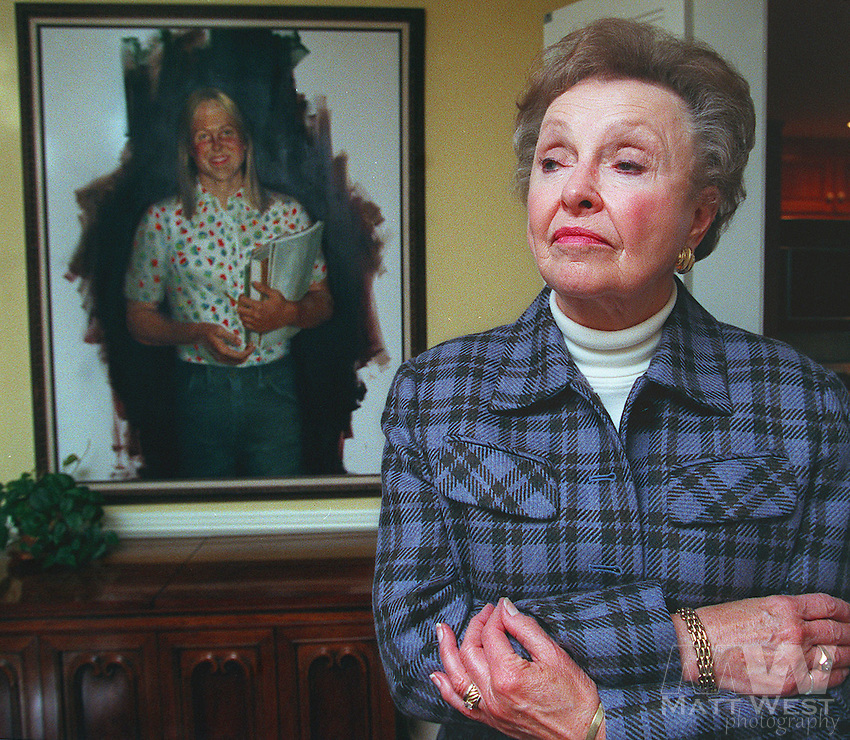 With a portrait of her daughter Martha Moxley behind her, Dorthy Moxley looks out the dining room window at her home in Chatham, NJ. 10/22/98 Staff Photo by Matt West