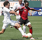 9 June 2007: United States defender Michael Parkhurst (left) toe-pokes the ball off the run of Trinidad and Tobago's Andre Toussaint (11). The United States Men's National Team defeated the National Team of Trinidad & Tobago 2-0 at the Home Depot Center in Carson, California in a first round game in the CONCACAF Gold Cup.