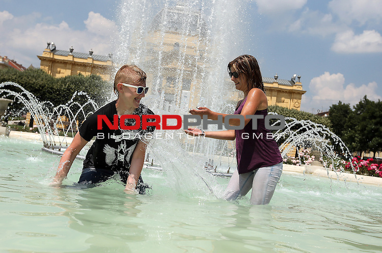 11.06.2015., Croatia, Zagreb - Young people of Zagreb   sought refreshment in fountains at King Tomislav Square. <br /> Foto &copy;  nph / PIXSELL / Robert Anic