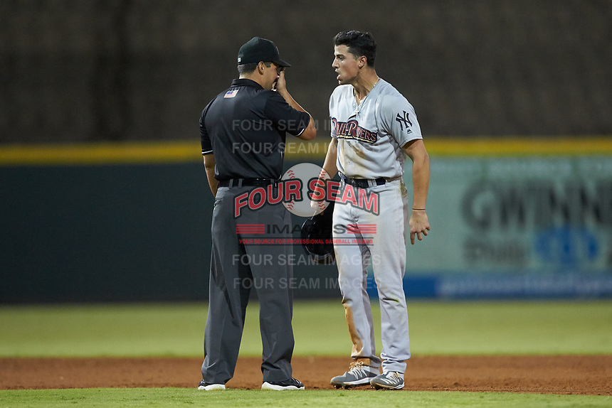 Mandy Alvarez (24) of the Scranton/Wilkes-Barre RailRiders argues with umpire Charlie Ramos after having been called out attempting to steal second base during the game against the Gwinnett Stripers at BB&T BallPark on August 17, 2019 in Lawrenceville, Georgia. The Stripers defeated the RailRiders 8-7 in eleven innings. (Brian Westerholt/Four Seam Images)