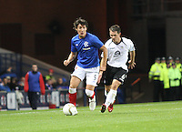 Francisco Sandaza closed down by Derek Young in the Rangers v Queen of the South Quarter Final match in the Ramsdens Cup played at Ibrox Stadium, Glasgow on 18.9.12.