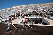 23rd October 2017, Women working outside the Samara Arena in Samara, Russia, 23 August 2017. The city is one of the many locations for the 2018 FIFA World Cup in Russia.