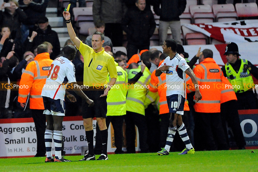 Sanmi Odelusi of Bolton Wanderers gets booked by Referee Darren Deadman  for celebrating too hard - AFC Bournemouth vs Bolton Wanderers - Sky Bet Championship Football at the Goldsands Stadium, Bournemouth, Dorset - 02/11/13 - MANDATORY CREDIT: Denis Murphy/TGSPHOTO - Self billing applies where appropriate - 0845 094 6026 - contact@tgsphoto.co.uk - NO UNPAID USE