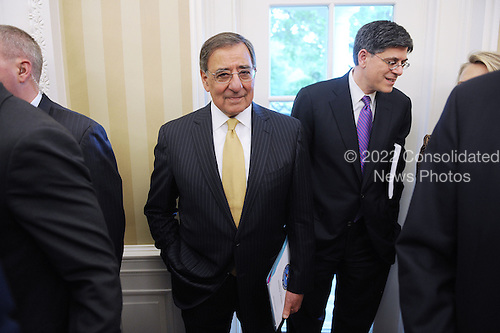 United States Secretary of Defense Leon Panetta  attends a meeting between President Barack Obama and Prime Minister Yoshihiko Noda of Japan in the Oval Office of the White House on April 30, 2012 in Washington DC.  Also pictured at right is White House Chief of Staff Jack Lew..Credit: Olivier Douliery / Pool via CNP