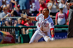 14 April 2018: Washington Nationals outfielder Moises Sierra argues a call at third in the 6th inning, attempting to stretch a double into a triple against the Colorado Rockies at Nationals Park in Washington, DC. The Nationals rallied to defeat the Rockies 6-2 in the 3rd game of their 4-game series. Mandatory Credit: Ed Wolfstein Photo *** RAW (NEF) Image File Available ***