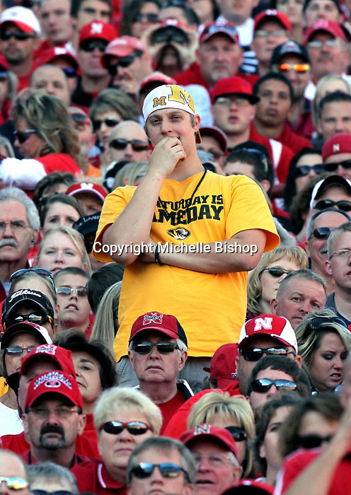 A lone Missouri fan looks on as his team falls behind during the second quarter. No. 14 Nebraska lead No. 7 Missouri 24-7 at halftime.