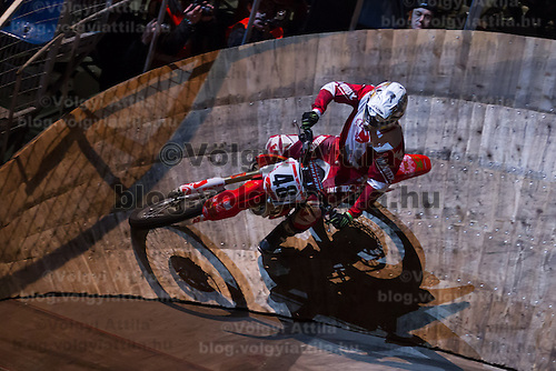Gabor Szatyina from Hungary competes during the Indoor Super Moto-Cross race in Budapest, Hungary on February 4, 2012. ATTILA VOLGYI