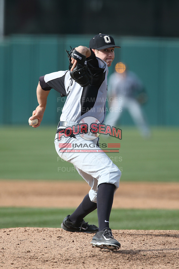 Collin Gee (29) of the Oakland Grizzlies pitches during a game against the Southern California Trojans at Dedeaux Field on February 21, 2015 in Los Angeles, California. Southern California defeated Oakland, 11-1. (Larry Goren/Four Seam Images)