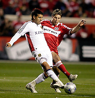 Chicago Fire midfielder Logan Pause (7) pressures Real Salt Lake midfielder Javier Morales (11).  Real Salt Lake defeated the Chicago Fire in a penalty kick shootout 0-0 (5-4 PK) in the Eastern Conference Final at Toyota Park in Bridgeview, IL on November 14, 2009.