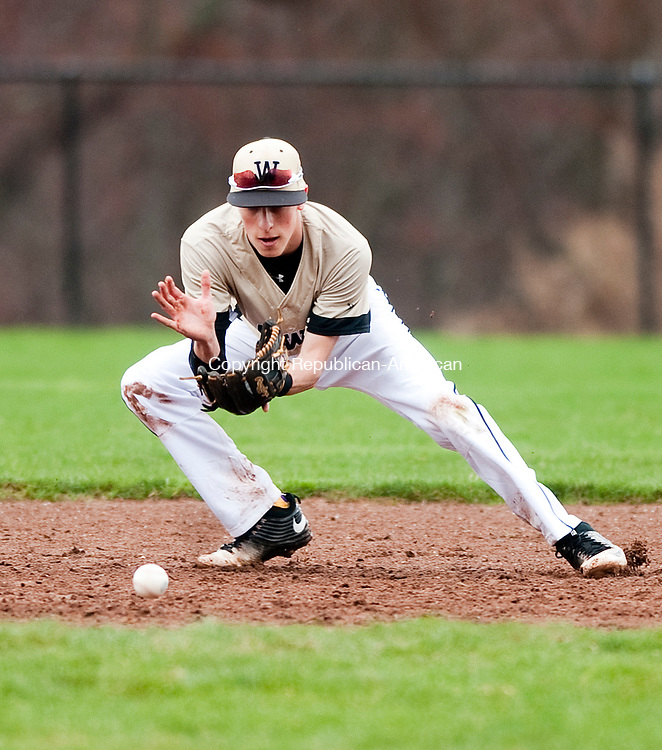 BEACON FALLS, CT-041117JS08- Woodland's Zak Graveline (3) scoops up a ground ball during their game against Watertown Wednesday at Woodland Regional High School in Beacon Falls. <br /> Jim Shannon Republican-American