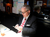 Michael Caputo, a Republican political strategist and media consultant, looks over his phone messages after lunch on Capitol Hill prior to his testimony before the United States House Permanent Select Committee on Intelligence as part of their investigation into Russian interference in Washington, DC on Friday, July 14, 2017.<br /> Credit: Ron Sachs / CNP