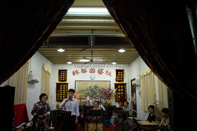 Amateur singers of the Huang Cantonese Opera group practise at their ancestral temple at Yanbu Village in Nanhai district of Foshan city, Guangdong province, November 8, 2011.