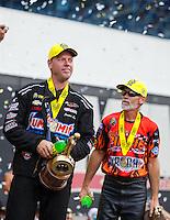 Sep 18, 2016; Concord, NC, USA; NHRA pro stock driver Jason Line (left) celebrates alongside pro stock motorcycle rider Chip Ellis after winning the Carolina Nationals at zMax Dragway. Mandatory Credit: Mark J. Rebilas-USA TODAY Sports