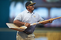 """Bradenton Marauders groundskeeper Victor Madrigal, """"The Dancing Dominican"""" performs after dragging the field in the seventh inning during a game against the Palm Beach Cardinals on August 8, 2016 at McKechnie Field in Bradenton, Florida.  Madrigal is a former minor league baseball player.  Bradenton defeated Palm Beach 5-4.  (Mike Janes/Four Seam Images)"""