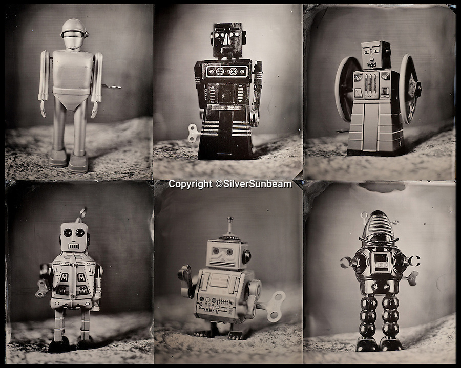 BNPS.co.uk (01202 558833)<br /> Pic: SilverSunbeam/BNPS<br /> <br /> **Please use full byline**<br /> <br /> A tintype photograph of robots.<br /> <br /> With the trend for instant images and all things digital, one photographer has turned his back on 21st century technology to embrace the 1800s.<br /> <br /> These black and white portraits look like they could have been taken 150 years ago, but they have all been taken in the last five years as part of a project to resurrect a Victorian photo technique.<br /> <br /> Instead of the quick snaps and filters of instagram and other digital apps, each picture takes up to 20 minutes to process.<br /> <br /> But photographer Andy Martin, 30, says it was the instant photo of its day.