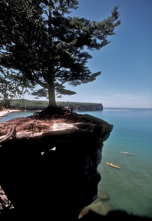 Lake Michigan, Sea kayakers explore the Pictured Rocks National Seashore, Upper Peninsula, Michigan, USA,