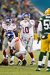 New York Giants quarterback Eli Manning (10) looks over the defense of the Green Bay Packers during an NFL divisional playoff football game on January 15, 2012 in Green Bay, Wisconsin. The Giants won 37-20. (AP Photo/David Stluka)