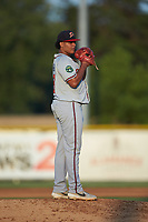 Danville Braves starting pitcher Lisandro Santos (57) looks to his catcher for the sign against the Burlington Royals at Burlington Athletic Stadium on August 9, 2019 in Burlington, North Carolina. The Royals defeated the Braves 6-0. (Brian Westerholt/Four Seam Images)