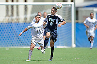 10 September 2011:  FIU's Nicholas Chase (8) heads the ball while Stetson's Jonathan Mendoza (11) watches in the first overtime period as the FIU Golden Panthers defeated the Stetson University Hatters, 3-2 in the second overtime period, at University Park Stadium in Miami, Florida.