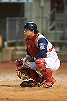Cedar Rapids Kernels catcher Alex Real (4) warms up the pitcher in between innings during a game against the Kane County Cougars on August 18, 2015 at Perfect Game Field in Cedar Rapids, Iowa.  Kane County defeated Cedar Rapids 1-0.  (Mike Janes/Four Seam Images)