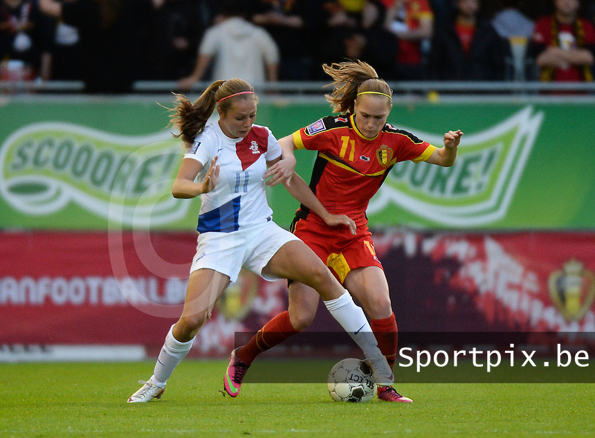 20140507 - LEUVEN , BELGIUM : Dutch Lieke Martens (l) pictured with Belgian Janice Cayman (r)  during the female soccer match between Belgium and The Netherlands, on the eighth matchday in group 5 of the UEFA qualifying round to the FIFA Women World Cup in Canada 2015 at Stadion Den Dreef , Leuven . Wednesday 7th May 2014 .  PHOTO DAVID CATRY
