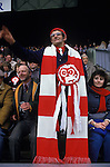 Man with home made very long scarf at Rugby match London UK