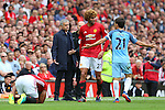 David Silva of Manchester City protests innocence to Jose Mourinho manager of Manchester United and Marouane Fellaini of Manchester United after tackled Luis Antonio Valencia of Manchester United during the Premier League match at Old Trafford Stadium, Manchester. Picture date: September 10th, 2016. Pic Simon Bellis/Sportimage