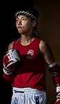 Au Yin Yin Winnie (Red) of Hong Kong enters to the ring prior the female muay 51KG division weight bout against Umeo Mei (Not in picture) of Japan during the East Asian Muaythai Championships 2017 at the Queen Elizabeth Stadium on 13 August 2017, in Hong Kong, China. Photo by Yu Chun Christopher Wong / Power Sport Images