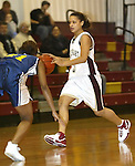 WATERBURY, CT,  02 JANUARY 2006, 010207BZ07- Sacred Heart's Kayla Kennedy (3) looks for room against Kennedy's Devondra Riddick (11) during their game at Sacred Heart High School in Waterbury Tuesday.<br /> Jamison C. Bazinet Republican-American