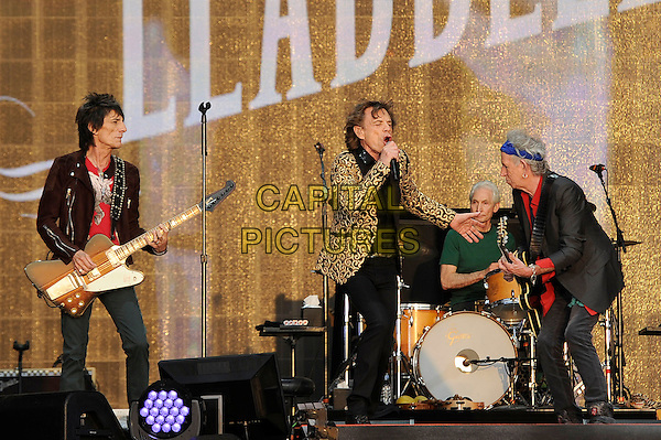 Ronnie Wood, Mick Jagger, Charlie Watts and Keith Richards of The Rolling Stones <br /> performing at Barclaycard British Summertime, Hyde Park, London, England, UK, <br /> 13th July 2013.<br /> music concert gig festival live on stage  full length microphone gold black patterned blazer jacket side playing guitar singing drummer band group <br /> CAP/MAR <br /> &copy; Martin Harris/Capital Pictures
