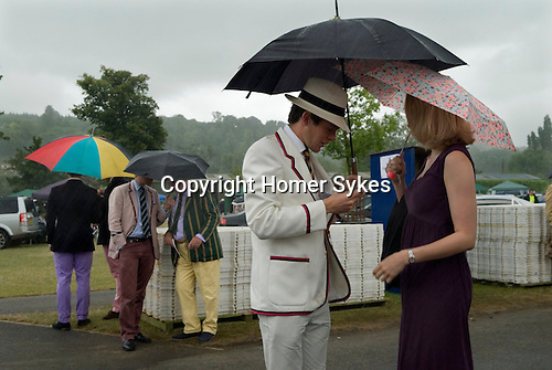 Henley on Thames Royal Regatta. UK. Couple looking for their tickets for the Stewards Enclosure.