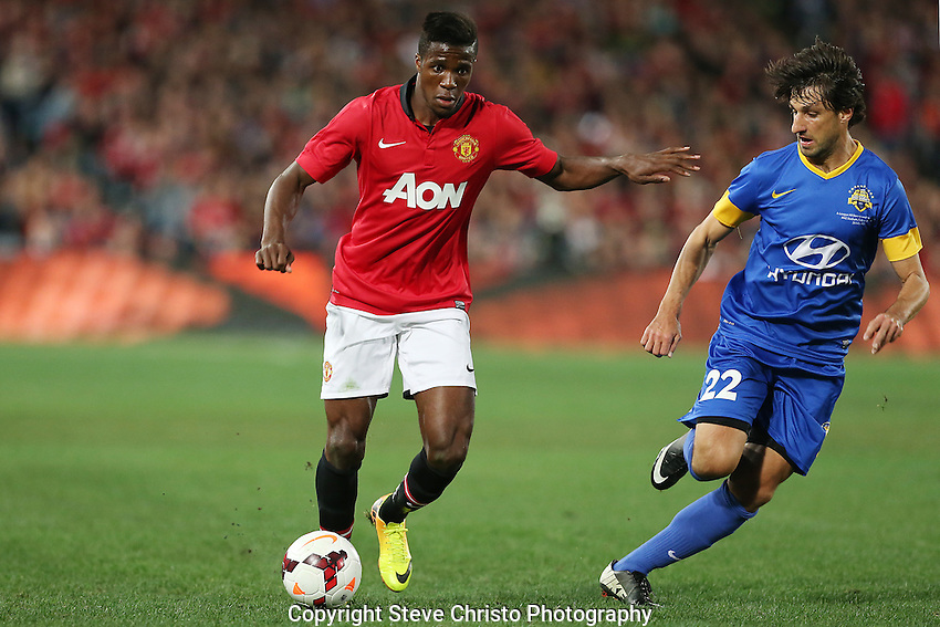 Manchester United's Wilfried Zaha fends off A-League All Stars  Thomas Broich at Stadium Australia, Sydney, Australia. Saturday, 20th July, 2013. (Photo: Steve Christo)