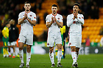 Jack O'Connell, Enda Stevens and Callum Robinson of Sheffield United celebrate in front of the away fans after the Premier League match at Carrow Road, Norwich. Picture date: 8th December 2019. Picture credit should read: James Wilson/Sportimage