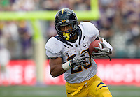 Isi Sofele of California runs the ball during the game against Washington at Seattle, Washington on September 24th, 2011.  Washington defeated California 31-23.