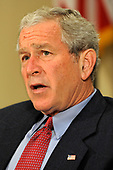 Washington, DC - September 14, 2008 -- United States President George W. Bush briefs the press on relief efforts in the aftermath of Hurricane Ike after a meeting with administration officials, 14 September 2008 at the White House.  Bush directed officials to closely monitor the price of fuels to prevent gouging to the nation's motorists. <br /> Credit: Mike Theiler / Pool via CNP