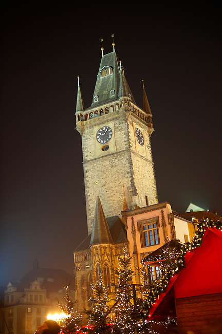 Christmas Market In Prague's Old Town Square with Town Hall tower at night