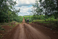 July 28, 2014 - Mondulkiri (Cambodia). Two Phnong women ride a motorbike inside one of the rubber plantations around Busra village. © Thomas Cristofoletti / Ruom