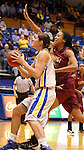 BROOKINGS, SD - JANUARY 9:  Megan Stuart #3 from South Dakota State University takes the ball to the basket past Shanika Maddox #21 from IUPUI in the first half of their game Thursday night at Frost Arena in Brookings. (Photo by Dave Eggen/Inertia)